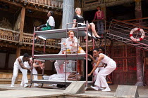 centre, shouting: Katy Owen (Malvolio) above: Nandi Bhebhe (Fabian), Carly Bawden (Maria) in TWELFTH NIGHT by Shakespeare opening at Shakespeare's Globe, London SE1 on 24/05/2017 design: Lez Brotherst...