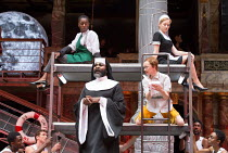 front: Le Gateau Chocolat (Feste), Katy Owen (Malvolio) above: Nandi Bhebhe (Fabian), Carly Bawden (Maria) in TWELFTH NIGHT by Shakespeare opening at Shakespeare's Globe, London SE1 on 24/05/2017 desi...