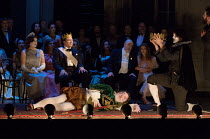 watching the play - l-r: Sarah Connolly (Gertrude), Rod Gilfry (Claudius), Kim Begley (Polonius), Barbara Hannigan (Ophelia) with (front) John Tomlinson (Player 1), James Newby (Player 4 - holding cro...