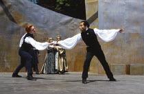 HAMLET by Shakespeare  design: Tanya McCallin  director: Tim Pigott-Smith  front, l-r: Damian Lewis (Hamlet), Guy Burgess (Laertes)  rear: Pamela Miles (Gertrude), Paul Freeman (Claudius) Open Air The...