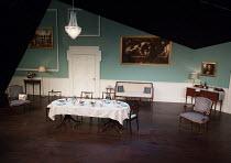 DESSERT by Oliver Cotton  design: Rachel Stone  lighting: Derek Anderson  director: Trevor Nunn   stage,set,full,empty,interior,door,dining,room,furniture,period,table,flowers,chairs,chandelier,painti...