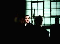 CORIOLANUS by Shakespeare  design: Paul Brown  lighting: Mark Henderson  director: Jonathan Kent facing his accusers: Ralph Fiennes (Coriolanus)Almeida Theatre/Gainsborough Studios, London N1  14/06/2...