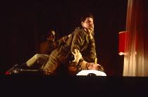 CORIOLAN after Shakespeare director: Robert Lepage  Coriolanus killed by a shot to the head - top right: Jules Philip (Coriolanus)  below: (Aufidius)Theatre Repere / Nottingham Playhouse, Nottingham,...