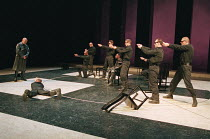 CORIOLANUS  by Shakespeare   design: Patrick Connellan   lighting: Jon Linstrum   director: Steven Berkoff far left: Steven Berkoff (Coriolanus)  seated centre: Colin McFarlane (Tullus Aufidius)West Y...