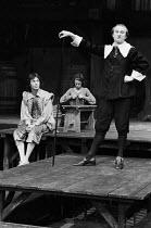 TWELFTH NIGHT by Shakespeare  design: Poppy Mitchell  lighting: Mike Alvey  director: Nancy Meckler left: Maynard Williams (Feste)  right: Neil Johnston (Malvolio) The Young Vic, London SE1  01/03/197...