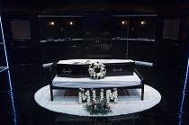 LOOT by Joe Orton  design: Gabriella Slade  lighting: Elliot Griggs  director: Michael Fentiman  stage,set,empty,interior,funeral parlour,coffin,body,corpse,flowers,bouquet,dark,blackPark Theatre, Lon...