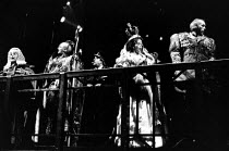 THE BALCONY  by Jean Genet  design: Farrah  lighting: Stewart Leviton  director: Terry Hands ~~left: Clement McCallin (Judge)  centre: Barry Stanton (Chief of Police / George)    right: Brenda Bruce (...