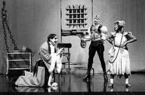 THE BALCONY  by Jean Genet  design: Farrah  lighting: Clive Morris & Terry Hands  director: Terry Hands l-r: Jim Carter (Judge), Howard Ward (Executioner), Vivienne Rochester (Thief) * Lo-res scan for...