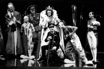 THE BALCONY  by Jean Genet  design: Farrah  lighting: Clive Morris & Terry Hands  director: Terry Hands l-r: Jim Carter (Judge), (tbc), Robert Demeger (General), Dilys Laye (Irma), Joe Melia (Chief of...