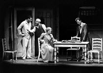 DEATH OF A SALESMAN by Arthur Miller  set design: John Gunter  costumes: Lindy Hemming  director: Michael Rudman l-r: Stephen Greif (Biff), Warren Mitchell (Willy Loman), Doreen Mantle (Linda), David...