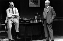 DEATH OF A SALESMAN by Arthur Miller  set design: John Gunter  costumes: Lindy Hemming  director: Michael Rudman l-r: Jerry Harte (Howard Wagner), Warren Mitchell (Willy Loman) * Lo-res scan for refer...