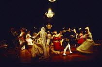 A PATRIOT FOR ME  by John Osborne  set design: Tom Piper  costumes: Pamela Howard  lighting: Andy Phillips  director: Peter Gill ~~ball scene  rear centre: Denis Quilley (Baron von Epp)~Royal Shakespe...