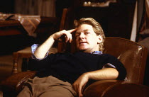 Kenneth Branagh (Jimmy Porter) in LOOK BACK IN ANGER by John Osborne at the Lyric Theatre, London W1  07/08/1989  a Renaissance Theatre Company production  design: Jenny Tiramani  lighting: Jon Linst...