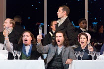 Cafe Momus - front, l-r: Florian Sempey (Schaunard), Michael Fabiano (Rodolfo), Nicole Car (Mimi)  in LA BOHEME by Puccini opening at The Royal Opera, London WC2 on 11/09/2017   conductor: Antonio Pap...