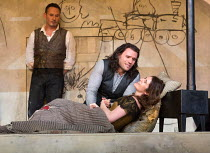 last act, Mimi lies dying: Michael Fabiano (Rodolfo), Nicole Car (Mimi) watched by Mariusz Kwiecien (Marcello) in LA BOHEME by Puccini opening at The Royal Opera, London WC2 on 11/09/2017 conductor: A...