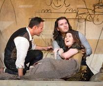 last act, Mimi lies dying - l-r: Mariusz Kwiecien (Marcello), Michael Fabiano (Rodolfo), Nicole Car (Mimi) in LA BOHEME by Puccini opening at The Royal Opera, London WC2 on 11/09/2017 conductor: Anton...