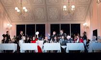 Cafe Momus - front, l-r: Wyn Pencarreg (Alcindoro - with top hat), Simona Mihai (Musetta), Mariusz Kwiecien (Marcello), Florian Sempey (Schaunard), Michael Fabiano (Rodolfo), Nicole Car (Mimi), Luca T...