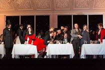 Cafe Momus - left: Wyn Pencarreg (Alcindoro - with top hat), Simona Mihai (Musetta)  standing, centre right: Michael Fabiano (Rodolfo), Nicole Car (Mimi) in LA BOHEME by Puccini opening at The Royal O...