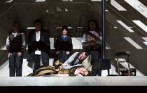 final scene, Mimi dies - front: Michael Fabiano (Rodolfo), Nicole Car (Mimi) watched by (rear, l-r) Mariusz Kwiecien (Marcello), Luca Tittoto (Colline), Simona Mihai (Musetta), Florian Sempey (Schauna...