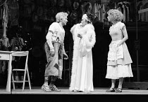 THE COMEDY OF ERRORS by Shakespeare  design: John Napier  lighting: Clive Morris  musical staging: Gillian Lynne  director: Trevor Nunn ~l-r: Michael Williams (Dromio of Syracuse), Judi Dench (Adriana...