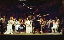 THE COMEDY OF ERRORS by Shakespeare  design: John Napier  lighting: Clive Morris  musical staging: Gillian Lynne  director: Trevor Nunn ~front left: Nickolas Grace (Dromio of Ephesus), Francesca Annis...