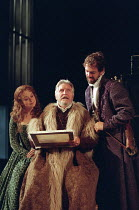 l-r: Cathryn Bradshaw (Ophelia), Denis Quilley (Polonius), Guy Lankester (Laertes) in  HAMLET by Shakespeare at the Lyttelton Theatre, National Theatre (NT), London SE1: first night 05/09/2000   desig...