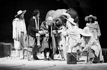 AS YOU LIKE IT by Shakespeare  design: John Napier  lighting: John Watts  director: Trevor Nunn   centre, l-r: Peter McEnery (Orlando), Jeffery Dench (Old Adam), (???), Oliver Ford-Davies (Duke Senior...