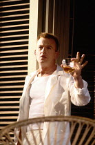 CAT ON A HOT TIN ROOF  by Tennessee Williams  design: William Dudley  lighting: Mark Henderson  director: Howard Davies   Ian Charleson (Brick) Lyttelton Theatre, National Theatre (NT), London SE1  03...