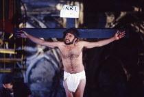 THE YORK MYSTERY PLAYS  adapted by Andrew Wickes  design: Tim Reed  lighting: Davy Cunningham  director: Steven Pimlott  on the cross: Victor Banerjee (Jesus)York Minster, York, England  16/06/1988  (...