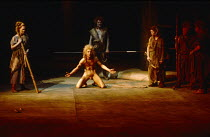 THE ROMANS IN BRITAIN by Howard Brenton  set design: Martin Johns  costumes: Stephanie Howard  lighting: Chris Ellis  director: Michael Bogdanov   centre: Greg Hicks (Marban / a druid)  Olivier Theatr...