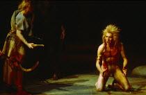 THE ROMANS IN BRITAIN by Howard Brenton  set design: Martin Johns  costumes: Stephanie Howard  lighting: Chris Ellis  director: Michael Bogdanov   right: Greg Hicks (Marban / a druid)  Olivier Theatre...