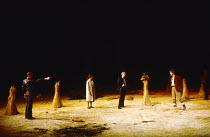 THE ROMANS IN BRITAIN by Howard Brenton  set design: Martin Johns  costumes: Stephanie Howard  lighting: Chris Ellis  director: Michael Bogdanov  modern Ireland, captured at gun point - left: Greg Hic...