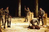 THE ROMANS IN BRITAIN by Howard Brenton  set design: Martin Johns  costumes: Stephanie Howard  lighting: Chris Ellis  director: Michael Bogdanov  modern Ireland, searched by British soldiers - right,...