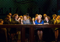 drinking with colleagues: Sasha Cooke (Marnie - in blue) in MARNIE opening at English National Opera (ENO), London Coliseum, WC2 on 18/11/2017     after the novel by Winston Graham  a co-commission wi...