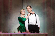 getting ready to go out: Sasha Cooke (Marnie), Daniel Okulitch (Mark Rutland) in MARNIE opening at English National Opera (ENO), London Coliseum, WC2 on 18/11/2017     after the novel by Winston Graha...