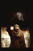THE ORESTEIA  by Aeschylus  in a version by Tony Harrison  design: Jocelyn Herbert assisted by Sue Jenkinson  lighting: John Bury  movement: Stuart Hopps  director: Peter Hall   'Agamemnon': Watchman...