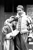 BARTHOLOMEW FAIR  by Ben Jonson  design: Patrick Robertson & Rosemary Vercoe  puppets: Graeme Galvin  director: Peter Barnes l-r: Christopher Ryan (Trouble-All), Christopher Biggins (Bartholomew Cokes...