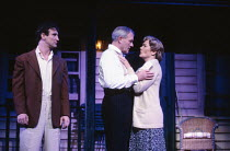 ALL MY SONS  by Arthur Miller   design: Saul Radomsky   lighting: Christopher Toulmin   director: Lou Stein   l-r: Mark McGann (Chris Keller), Julian Glover (Joe Keller), Diane Fletcher (Kate Keller...