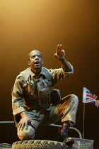 HENRY V by Shakespeare design: Tim Hatley lighting: Mark Henderson director: Nicholas Hytner   Adrian Lester (King Henry V) Olivier Theatre, National Theatre, London SE1  13/05/2003 (c) Donald Coop...