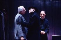 MURDER IN THE CATHEDRAL  by T.S.Eliot design: Ashley Martin-Davis   lighting: Brian Harris  director: Steven Pimlott   l-r: Clifford Rose (2nd Priest), Michael Feast (Thomas Becket), Robin Soans (3rd...