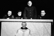 MURDER IN THE CATHEDRAL  by T.S.Eliot  design: Farrah  lighting: Stewart Leviton  director: Terry Hands   rear, l-r: Anthony Pedley (Second Tempter / Second Knight), Bernard Lloyd (First Tempter / Fir...