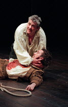 THE SPANISH TRAGEDY  by Thomas Kyd  design: Tom Piper  lighting: Robert Bryan  director: Michael Boyd  Peter Wight (Hieronimo) with the body of his son Horatio (Tristan Sturrock)Royal Shakespeare Comp...