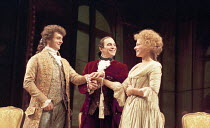 AMADEUS   by Peter Shaffer   design: Bill Dudley   director: Peter Hall ~~l-r: Michael Sheen (as Wolfgang Amadeus Mozart), David Suchet (as Antonio Salieri), Lucy Whybrow (Constanze Weber) ~Old Vic Th...