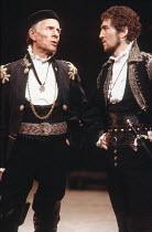 THE SPANISH TRAGEDY  by Thomas Kyd  design: Chris Dyer  lighting: Leonard Tucker  director: Michael Bogdanov   l-r: Basil Henson (Cyprian), Greg Hicks (Lorenzo) Cottesloe Theatre, National Theatre (NT...