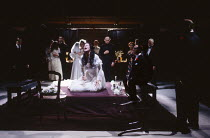 'TIS PITY SHE'S A WHORE by John Ford design: Kenny Miller director: David Leveaux  Annabella & Soranzo's wedding party - centre, Hippolita is poisoned: Celia Gregory (Hippolita), (seated right) Jonat...