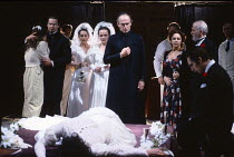 'TIS PITY SHE'S A WHORE by John Ford design: Kenny Miller director: David Leveaux  Annabella & Soranzo's wedding party - centre, Hippolita lies dead, poisoned - rear left: : Terence Wilton (Richardet...