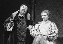 VOLPONE or The Fox by Ben Jonson set design: John Bury costumes: Deirdre Clancy lighting: David Hersey director: Peter Hall  Michael Medwin (Corvino), Morag Hood (Celia) Olivier Theatre, National Thea...