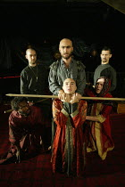 TAMBURLAINE THE GREAT by Christopher Marlowe adapted by Ben Power design: Katy Tuxford director: Ben Naylor ~the killing of Calyphas - centre (top) Khalid Abdalla (Tamburlaine), Nathanael Wiseman (Cal...