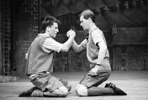 BLOOD BROTHERS book, music & lyrics by Willy Russell design: Marty Flood lighting: Jon Swain director: Bob Tomson ~l-r: Con O'Neill (Mickey Johnstone), Robert Locke (Edward Lyons) Albery Theatre, Lond...