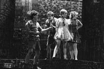 BLOOD BROTHERS book, music & lyrics by Willy Russell design: Andy Greenfield lighting: Jimmy Simmons directed by Chris Bond & Danny Hiller  l-r: Peter Christian (Sammy), George Costigan (Mickey), Kat...